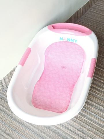 Tub & Bath Seat/ Support Net (Bath Seat/ Support is optional but very helpful I Available at Baby Company & Department Stores)